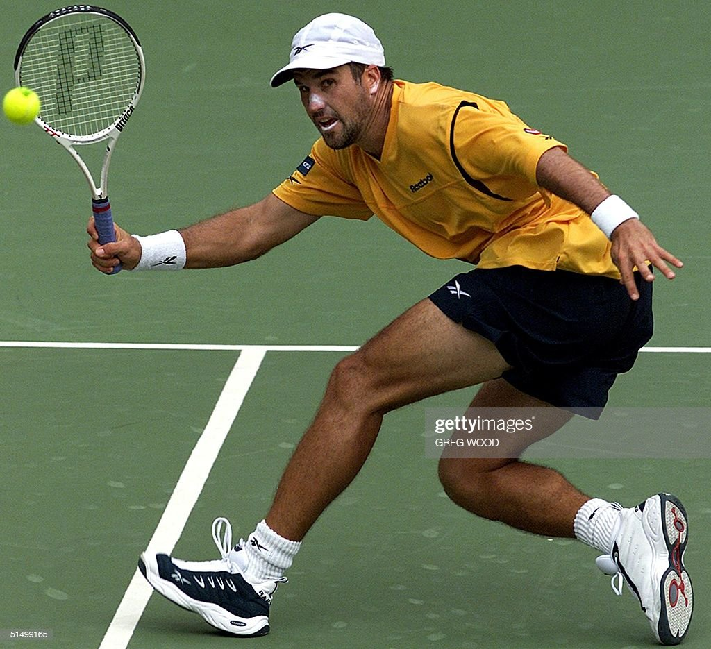 Patrick Rafter of Australia plays a return against