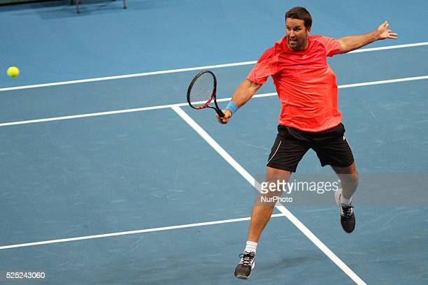 Patrick Rafter of the Singapore Slammers makes a backhand return to Fabrice Sontoro of the Indian Aces during their singles match at the...