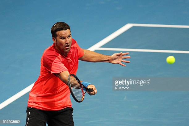 Patrick Rafter of the Singapore Slammers makes a forehand return to Fabrice Sontoro of the Indian Aces during their singles match at the...