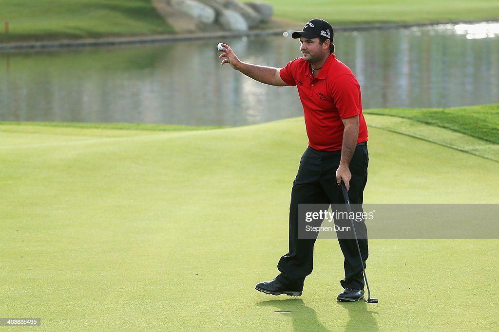 Patrick Reed acknowledges the gallery on the 18th hole after winning the Humana Challenge in partnership with the Clinton Foundation on the Arnold...