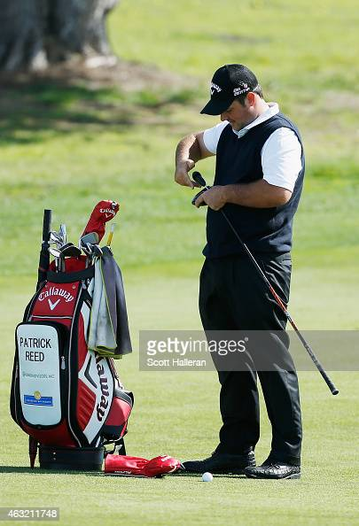 Patrick Reed adjusts his driver in practice for the ATT Pebble Beach National ProAm at the Monterey Peninsula Country Club on February 11 2015 in...