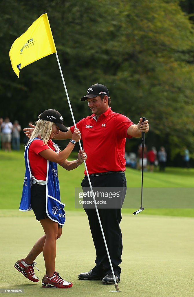 Patrick Reed and his wife Justine celebrate after defeating Jordan Spieth on the second hole of a playoff during the final round of the Wyndham Championship at Sedgefield Country Club on August 18, 2013 in Greensboro, North Carolina.