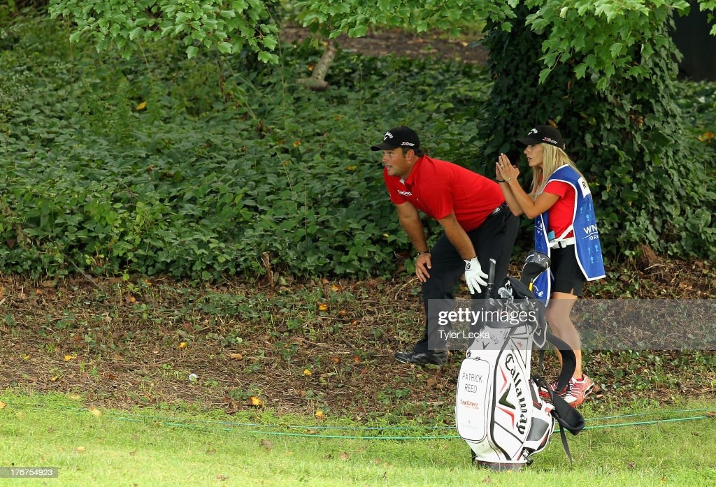 Patrick Reed and his wife Justine look over a shot on the 10th hole during a playoff against Jordan Spieth in the final round of the Wyndham Championship at Sedgefield Country Club on August 18, 2013 in Greensboro, North Carolina.