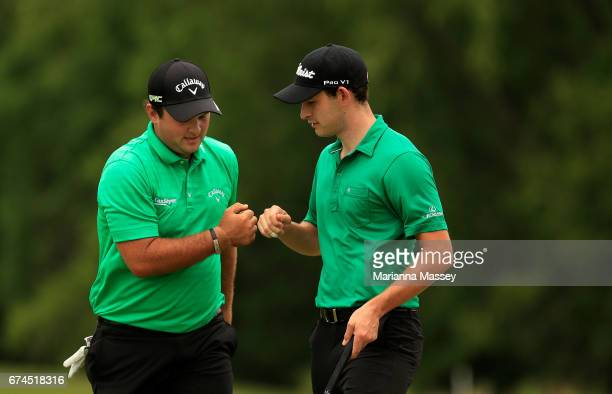 Patrick Reed and Patrick Cantlay react to their putt on the 16th hole during the second round of the Zurich Classic at TPC Louisiana on April 28 2017...