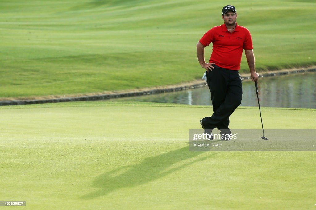 Patrick Reed assesses a putt on the 18th green during the final round of the Humana Challenge in partnership with the Clinton Foundation on the...
