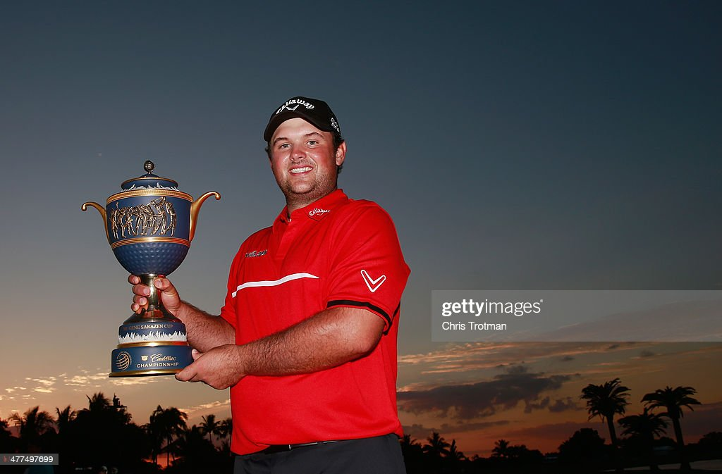 Patrick Reed celebrates with the Gene Sarazen Cup after his onestroke victory during the final round of the World Golf ChampionshipsCadillac...