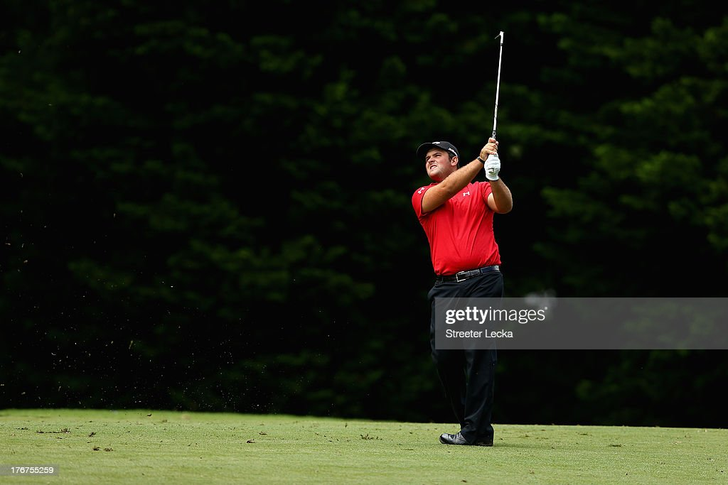 Patrick Reed hits a shot on the 13th hole during the final round of the Wyndham Championship at Sedgefield Country Club on August 18, 2013 in Greensboro, North Carolina.