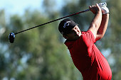 Patrick Reed hits a tee shot at the thirteenth hole of La Quinta Country Club Course during the second round of the Humana Challenge in partnership...