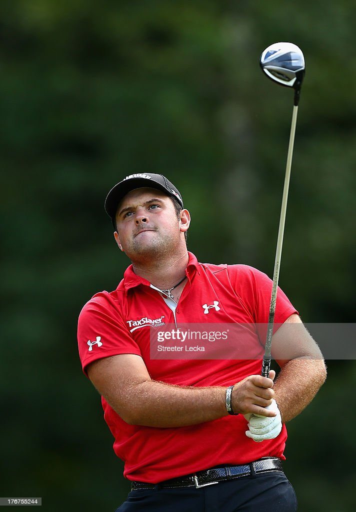 Patrick Reed hits a tee shot on the 14th hole during the final round of the Wyndham Championship at Sedgefield Country Club on August 18, 2013 in Greensboro, North Carolina.