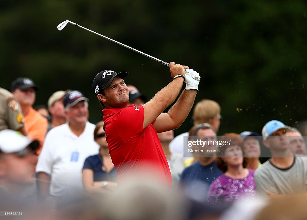 Patrick Reed hits a tee shot on the 16th hole during the final round of the Wyndham Championship at Sedgefield Country Club on August 18, 2013 in Greensboro, North Carolina.