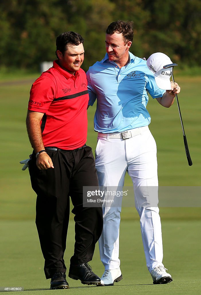 <a gi-track='captionPersonalityLinkClicked' href=/galleries/search?phrase=Patrick+Reed&family=editorial&specificpeople=846151 ng-click='$event.stopPropagation()'>Patrick Reed</a> (L) is congratulated by <a gi-track='captionPersonalityLinkClicked' href=/galleries/search?phrase=Jimmy+Walker+-+Jogador+de+golfe&family=editorial&specificpeople=11493198 ng-click='$event.stopPropagation()'>Jimmy Walker</a> after Reed defeated Walker in a playoff on the 18th hole to win the final round of the Hyundai Tournament of Champions at Plantation Course at Kapalua Golf Club on January 12, 2015 in Lahaina, Hawaii.