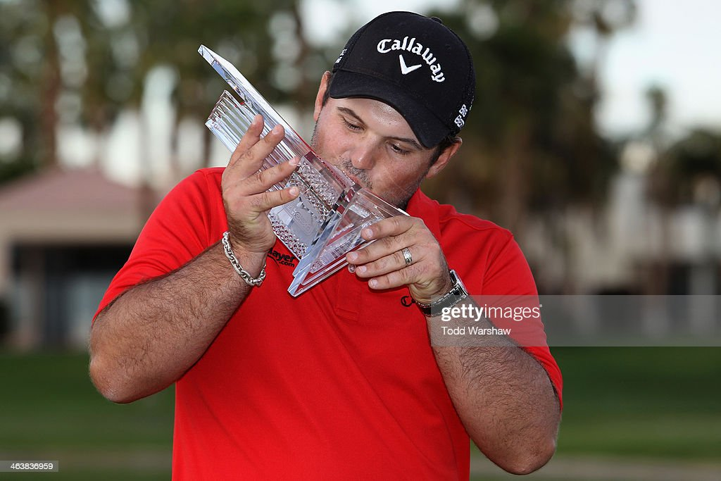 Patrick Reed kisses his trophy on the 18th green after winning the Humana Challenge in partnership with the Clinton Foundation on the Arnold Palmer...