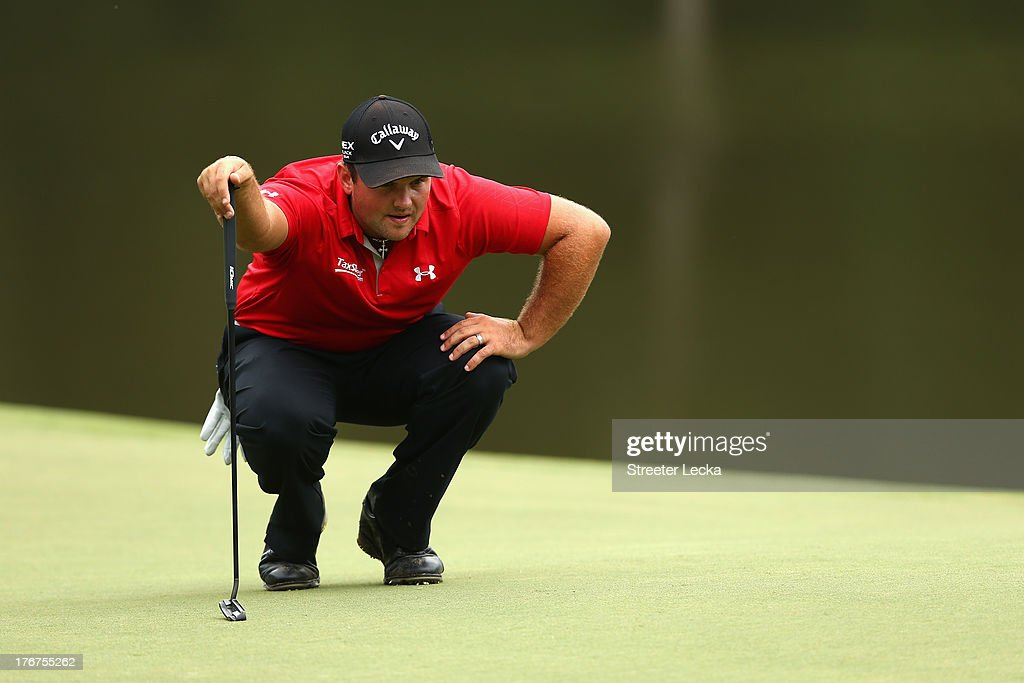 Patrick Reed lines up a putt on the 16th hole during the final round of the Wyndham Championship at Sedgefield Country Club on August 18, 2013 in Greensboro, North Carolina.