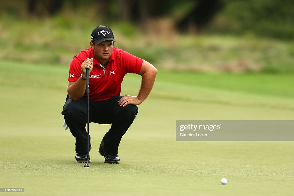 Patrick Reed lines up a putt on the 8th hole during the final round of the Wyndham Championship at Sedgefield Country Club on August 18, 2013 in Greensboro, North Carolina.
