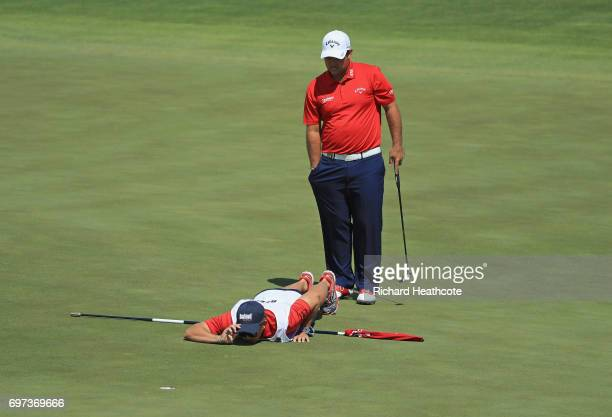 Patrick Reed of the United States and caddie Kessler Karain line up a putt on the third green during the final round of the 2017 US Open at Erin...