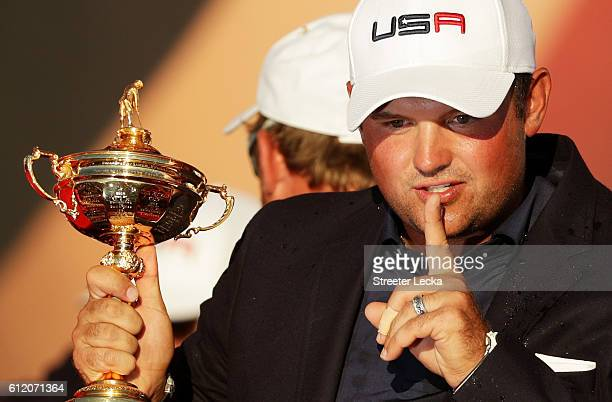 Patrick Reed of the United States gestures to the crowd while holding the Ryder Cup during the closing ceremony after defeating Europe singles...