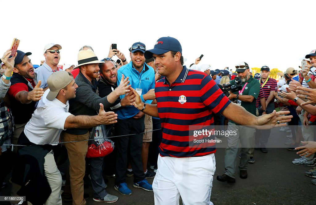 Patrick Reed of the United States high fives fans after winning his match during afternoon fourball matches of the 2016 Ryder Cup at Hazeltine National Golf Club on October 1, 2016 in Chaska, Minnesota.