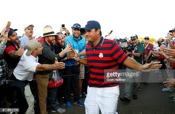 Patrick Reed of the United States high fives fans after winning his match during afternoon fourball matches of the 2016 Ryder Cup at Hazeltine...