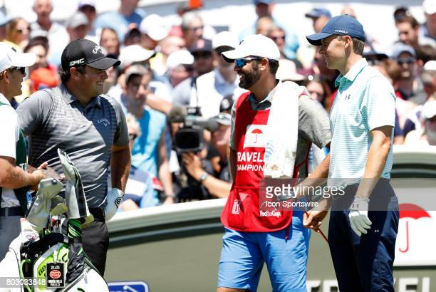 Patrick Reed of the United States Michael Greller and Jordan Spieth of the United States have a laugh on the first tee during the third round of the...