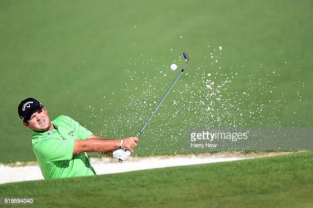 Patrick Reed of the United States plays a shot from a bunker on the second hole during the first round of the 2016 Masters Tournament at Augusta...