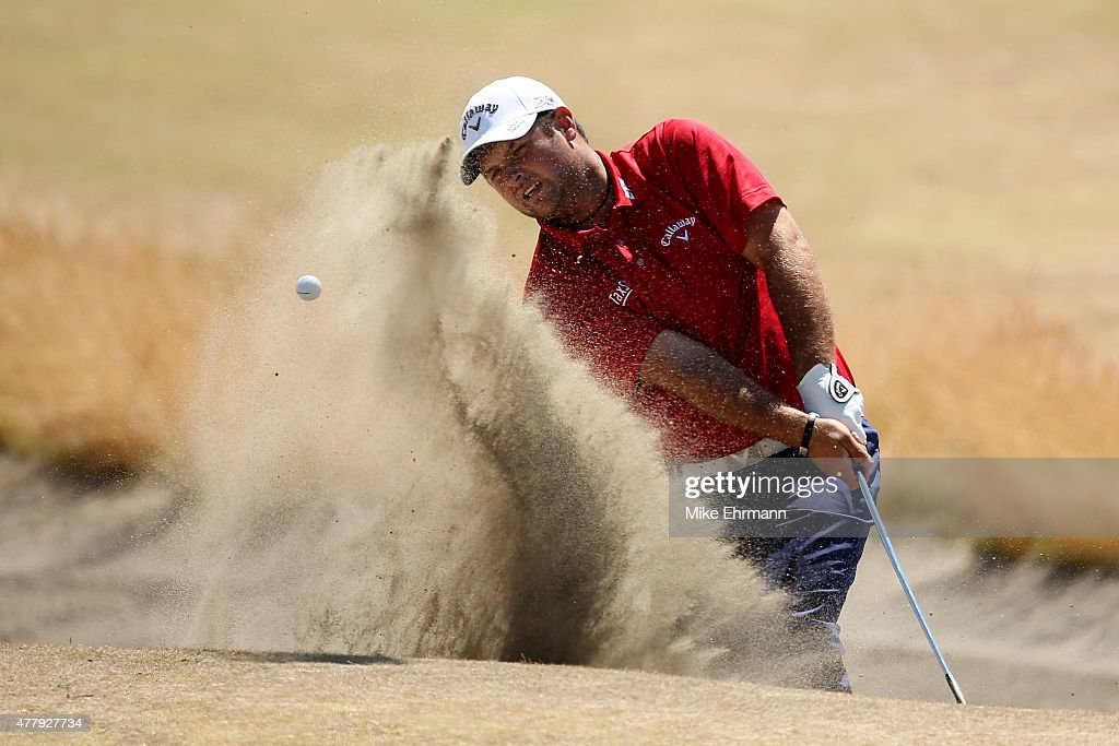 Patrick Reed of the United States plays his second bunker shot on the second hole during the third round of the 115th US Open Championship at...