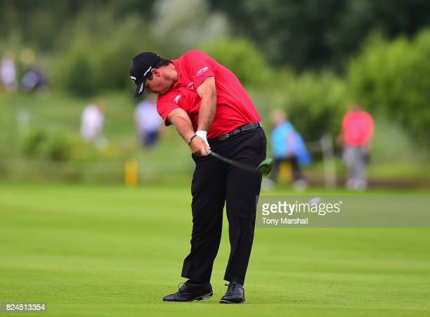 Patrick Reed of the United States plays his second shot on the 9th fairway during the Porsche European Open Day Four at Green Eagle Golf Course on...