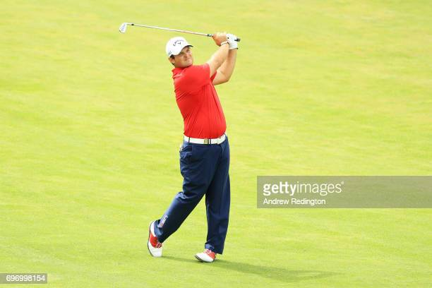 Patrick Reed of the United States plays his shot on the 17th hole during the third round of the 2017 US Open at Erin Hills on June 17 2017 in...