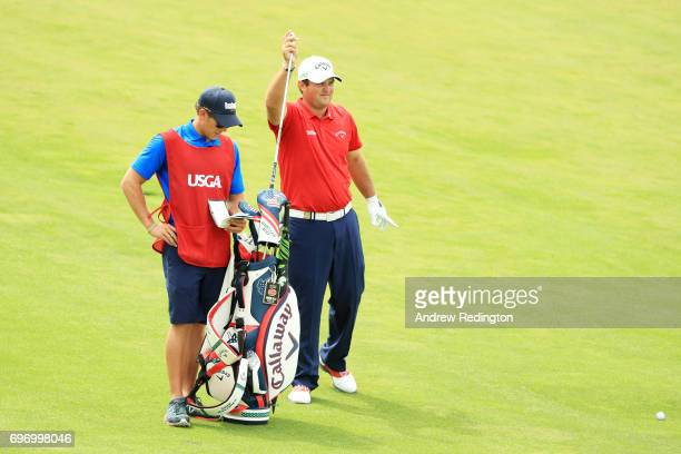Patrick Reed of the United States pulls a club from his bag as he prepares to play a shot on the 17th hole during the third round of the 2017 US Open...