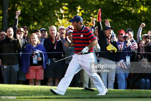 Patrick Reed of the United States reacts after a putt on the fifth green during morning foursome matches of the 2016 Ryder Cup at Hazeltine National...
