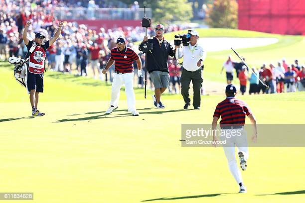 Patrick Reed of the United States reacts after holing out on the sixth hole during afternoon fourball matches of the 2016 Ryder Cup at Hazeltine...