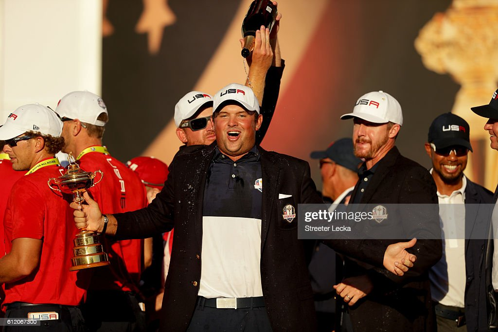 Patrick Reed of the United States reacts while holding the Ryder Cup during the closing ceremony after defeating Europe singles matches of the 2016 Ryder Cup at Hazeltine National Golf Club on October 2, 2016 in Chaska, Minnesota.