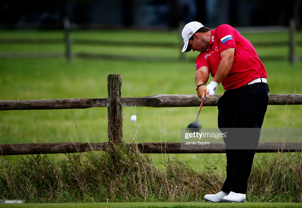 Patrick Reed plays his shot from the 12th tee during the Second Round of the BMW Championship at Conway Farms Golf Club on September 18, 2015 in Lake Forest, Illinois.