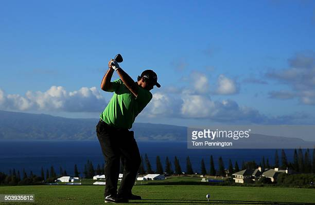 Patrick Reed plays his shot from the 18th tee during round one of the Hyundai Tournament of Champions at the Plantation Course at Kapalua Golf Club...