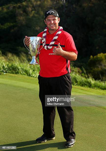 Patrick Reed poses with the winner's trophy after the final round of the Hyundai Tournament of Champions at Plantation Course at Kapalua Golf Club on...