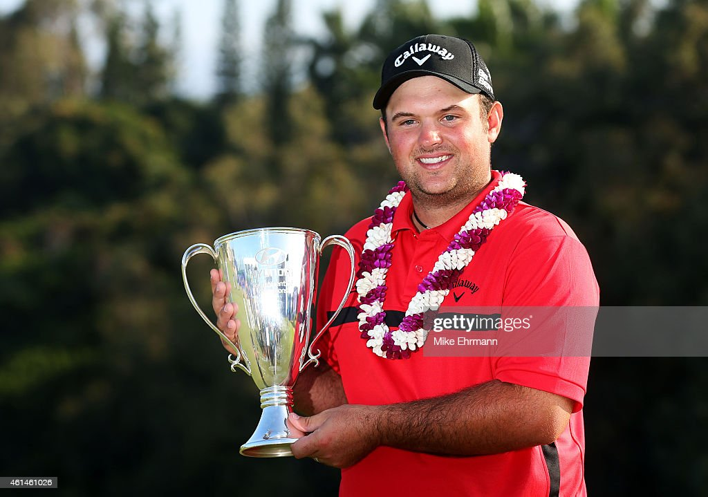 Patrick Reed poses with the winner's trophy after winning during the final round of the Hyundai Tournament of Champions at Plantation Course at Kapalua Golf Club on January 12, 2015 in Lahaina, Hawaii.