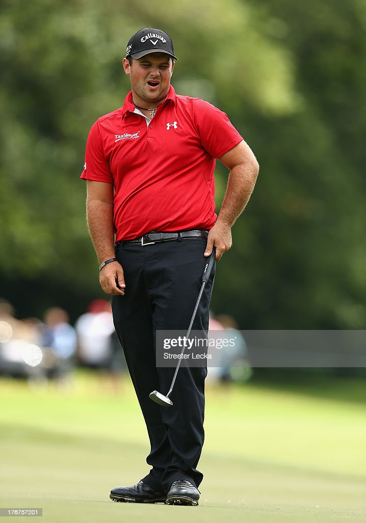 Patrick Reed reacts to a putt during the final round of the Wyndham Championship at Sedgefield Country Club on August 18, 2013 in Greensboro, North Carolina.