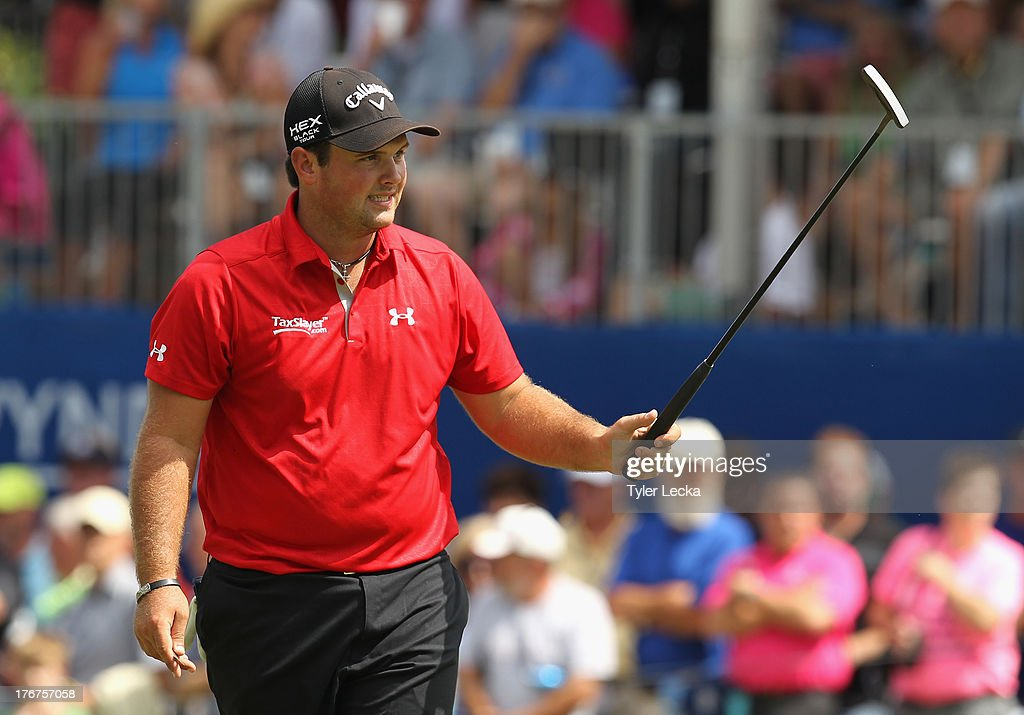 Patrick Reed reacts to a putt on the 18th hole after finishing his round in the final round of the Wyndham Championship at Sedgefield Country Club on August 18, 2013 in Greensboro, North Carolina.