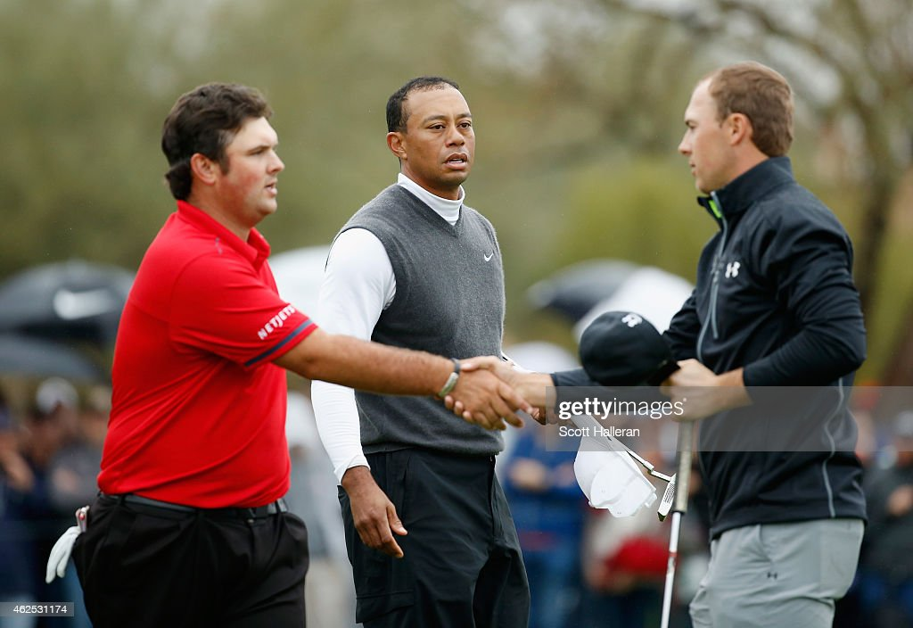 <a gi-track='captionPersonalityLinkClicked' href=/galleries/search?phrase=Patrick+Reed&family=editorial&specificpeople=846151 ng-click='$event.stopPropagation()'>Patrick Reed</a> shakes hands with <a gi-track='captionPersonalityLinkClicked' href=/galleries/search?phrase=Jordan+Spieth&family=editorial&specificpeople=5440480 ng-click='$event.stopPropagation()'>Jordan Spieth</a> on the ninth green as <a gi-track='captionPersonalityLinkClicked' href=/galleries/search?phrase=Tiger+Woods&family=editorial&specificpeople=157537 ng-click='$event.stopPropagation()'>Tiger Woods</a> looks on. Woods shot an 11-over par 82 during the second round of the Waste Management Phoenix Open at TPC Scottsdale on January 30, 2015 in Scottsdale, Arizona.
