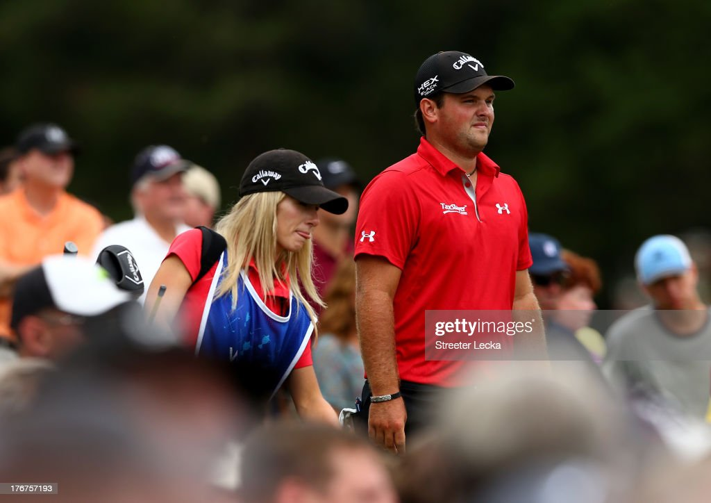 Patrick Reed walks with his caddie and wife Justine Reed during the final round of the Wyndham Championship at Sedgefield Country Club on August 18, 2013 in Greensboro, North Carolina.