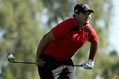 Patrick Reed watches his tee shot at the thirteenth hole of La Quinta Country Club Course during the second round of the Humana Challenge in...