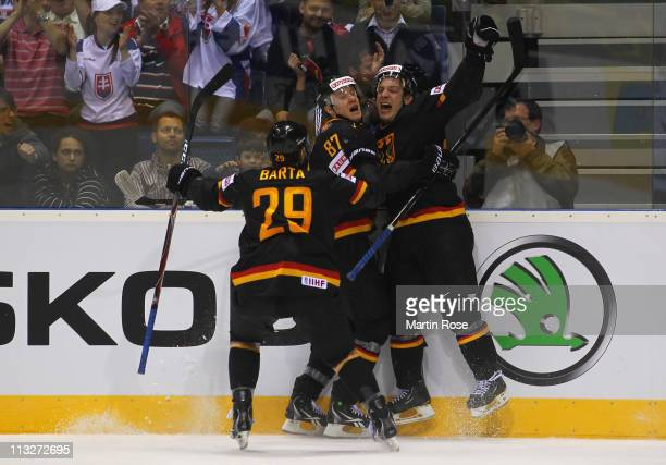 Patrick Reimer of Germany celebrate with his team mates after he scores his team's 2nd goal uring the IIHF World Championship group A match between...