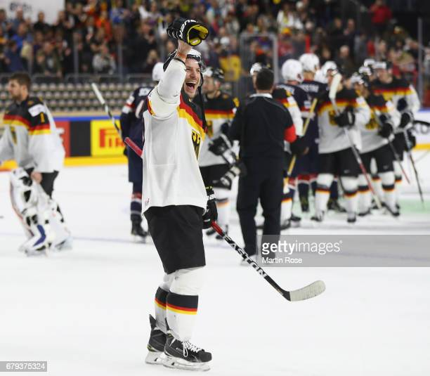 Patrick Reimer of Germany celebrates at the end of the 2017 IIHF Ice Hockey World Championship game between USA and Germany at Lanxess Arena on May 5...