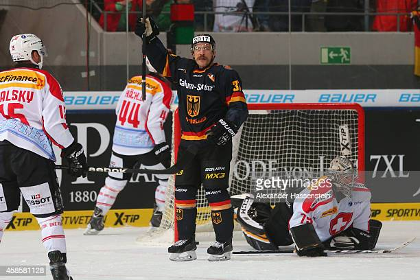 Patrick Reimer of Germany celebrates scoring the first goal against Daniel Manzato goalie of Switzerland during match 2 of the Deutschland Cup 2014...