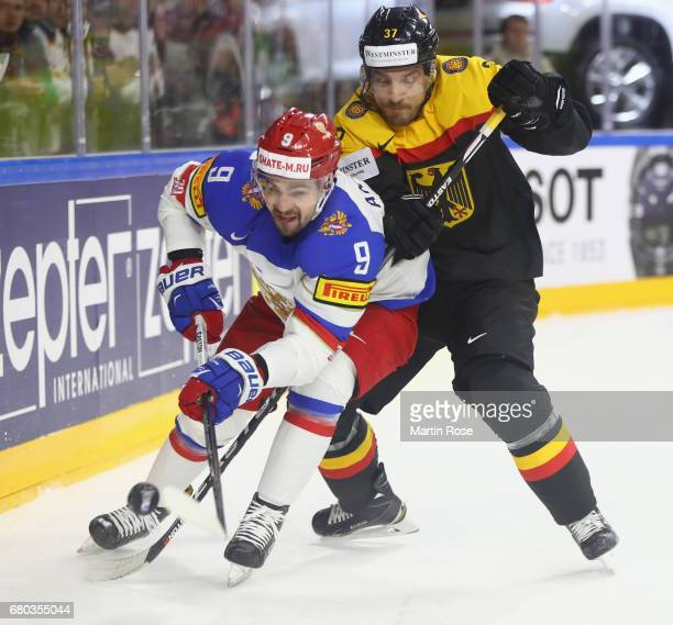 Patrick Reimer of Germany challenges Viktor Antipin of Russia during the 2017 IIHF Ice Hockey World Championship game between Germany and Russia at...