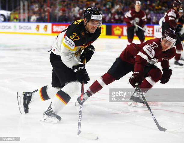 Patrick Reimer of Germany is challenged by Arturs Kulda of Latvia during the Germany v Latvia match of the 2017 IIHF Ice Hockey World Championships...