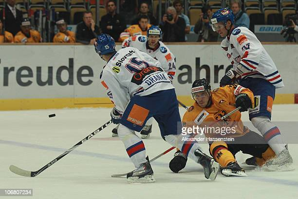 Patrick Reimer of Germany race for the puck against Dominik Granak of Slovakia and his team mate Branislav Mezei during the German Ice Hockey Cup...