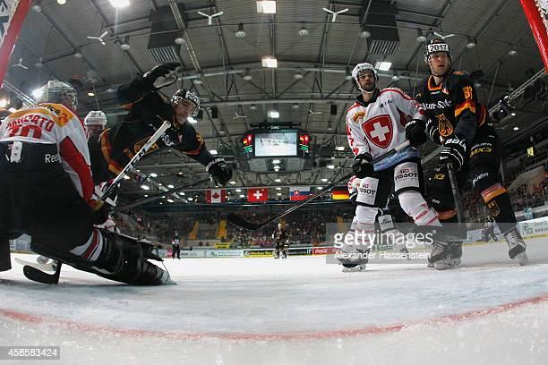 Patrick Reimer of Germany scores the second team goal against Daniel Manzato goalie of Switzerland during match 2 of the Deutschland Cup 2014 between...