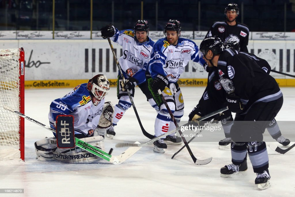 Patrick Reimer of Ice Tigers tries to score against goalkeeper Jason Bacashihua of Straubing during the DEL match between Thomas Sabo Ice Tigers and Straubing Tigers at Arena Nuernberger Versicherung on December 11, 2012 in Nuremberg, Germany.