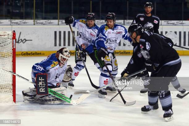 Patrick Reimer of Ice Tigers tries to score against goalkeeper Jason Bacashihua of Straubing during the DEL match between Thomas Sabo Ice Tigers and...