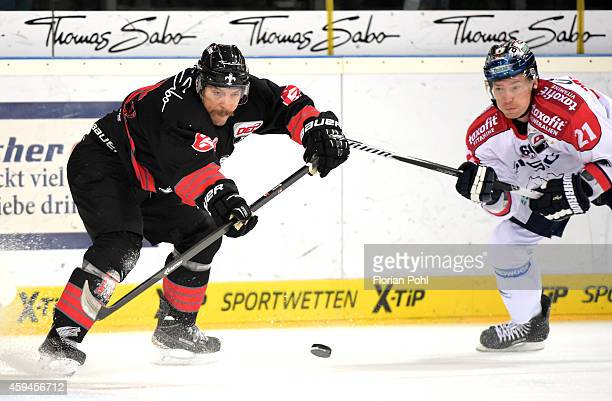 Patrick Reimer of the Thomas Sabo Ice Tigers Nuernberg and Antti Miettinen of the Eisbaeren Berlin duel during the game between Thomas Sabo Ice...